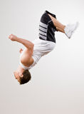 Skilled athlete doing somersault in mid-air Royalty Free Stock Image