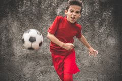 Skilled boy playing football Royalty Free Stock Photography
