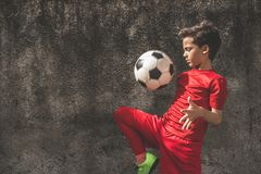 Skilled boy playing football. Brazilian football player, a true national passion Stock Photo