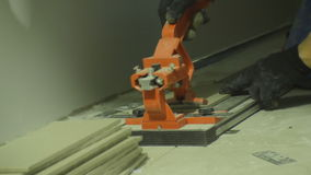 Skilled Builder Cuts Ceramic Tiles with Special Modern Tool stock video