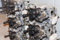 Skilled car engine maintenance. Close up shot of car engine reparation Royalty Free Stock Image
