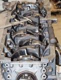 Skilled car engine maintenance. Close up shot of car engine reparation Royalty Free Stock Images
