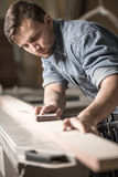 Skilled carpenter working Royalty Free Stock Photo