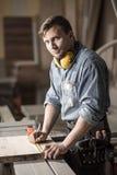 Skilled carpenter in workshop Stock Image