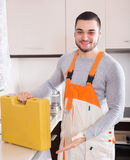Skilled craftsman with toolbox Royalty Free Stock Photos
