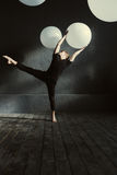 Skilled dancer performing in front of the dark wall Stock Photo