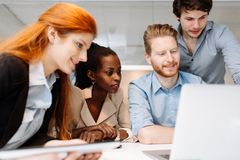 Skilled designers and business people working. In tidy modern office royalty free stock photos