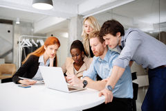 Skilled designers and business people working. In tidy modern office stock photos