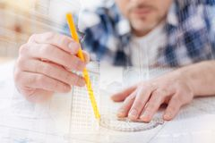 Free Skilled Engineer Taking Measurements Stock Photography - 101260652