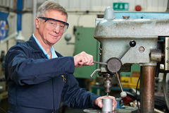 Skilled Engineer Using Drill In Factory Stock Image