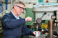 Skilled Engineer Using Drill In Factory Royalty Free Stock Photos