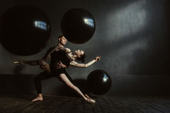 Skilled gymnasts stretching in interaction with each other Royalty Free Stock Photo