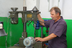 Skilled labourer with drilling machine Royalty Free Stock Photos