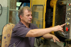 Skilled labourer in factory Stock Photos