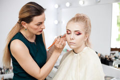 Skilled Make up artist in working process Stock Image