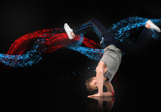 Skilled male dancer balancing on his forearms Stock Photography
