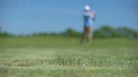 Skilled man playing golf rejoicing good long distance shot result, sport victory. Stock footage stock video