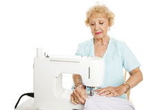 Skilled Senior Seamstress Royalty Free Stock Photo