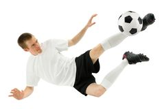 Skilled soccer player in midair Royalty Free Stock Images