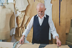 Skilled Tailor Making Bespoke Garments in Atelier Stock Image