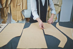 Skilled Tailor Making Custom Suit in Atelier Royalty Free Stock Photos