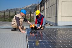 Fitting photovoltaic panels Stock Photography