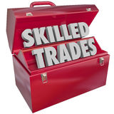 Skilled Trades Toolbox Technician Mechanic Blue Collar Work Job. Skilled Trades words in 3d letters in a red metal toolbox to illustrate blue collar work in a Stock Images
