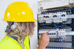 Skilled woman electrician Royalty Free Stock Photography
