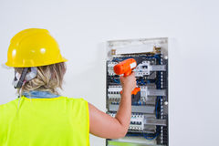 Skilled woman electrician Royalty Free Stock Image