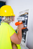 Skilled woman electrician Stock Photos