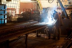 Skilled working factory welder stock images