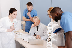 Skilled young interns studying in the medical college Stock Photo