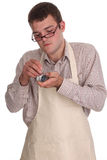 Skilled young man repairing a watch Stock Photo