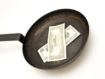 Skillet with dollars Royalty Free Stock Photo
