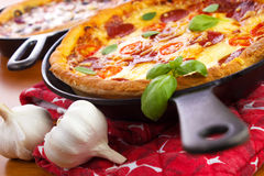 Skillet pizzas Royalty Free Stock Photography