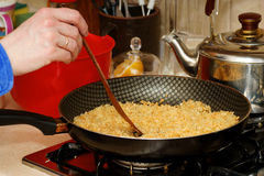 Skillet with rice Stock Images