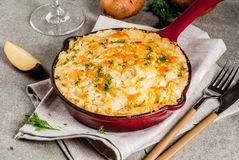 Skillet Shepherd`s Pie. British casserole in cast iron pan, with minced meat, mashed potatoes and vegetables, on gray stone background, copy space top view Royalty Free Stock Photography