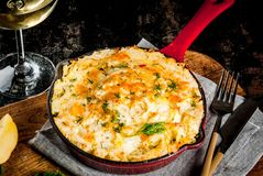Skillet Shepherd`s Pie. British casserole in cast iron pan, with minced meat, mashed potatoes and vegetables, on dark rusty background, copy space Stock Images