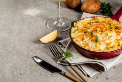 Skillet Shepherd`s Pie. British casserole in cast iron pan, with minced meat, mashed potatoes and vegetables, on gray stone background, copy space Royalty Free Stock Images