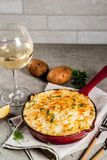Skillet Shepherd`s Pie. British casserole in cast iron pan, with minced meat, mashed potatoes and vegetables, on gray stone background, copy space Royalty Free Stock Image