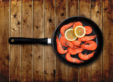 Skillet with shrimp Stock Photography