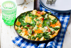 Skillet Strata with Bacon, Cheddar, and Greens Royalty Free Stock Photos
