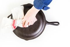 Skillet. Traditional cast iron skillet on a white background Royalty Free Stock Photo