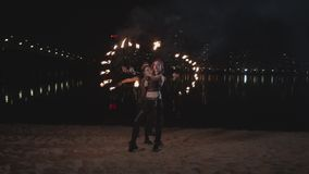 Cool fireshow artists juggling standing on by one stock video
