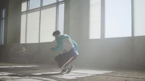 Skillful attractive rapper dancing in an abandoned building. Hip hop culture. Rehearsal. Young rapper dancing in an abandoned building. Hip hop culture stock video footage
