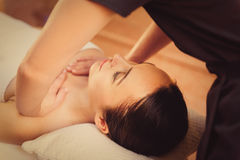 Skillful beautician massaging female body Royalty Free Stock Image