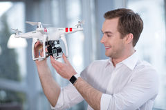 Skillful drone maker is working with joy Royalty Free Stock Images