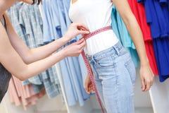 Skillful fashion designer measuring female body Stock Image