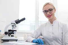 Skillful female researcher is expressing positive emotions Royalty Free Stock Photography