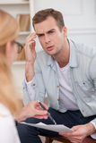 Skillful female therapist is consulting her Stock Images